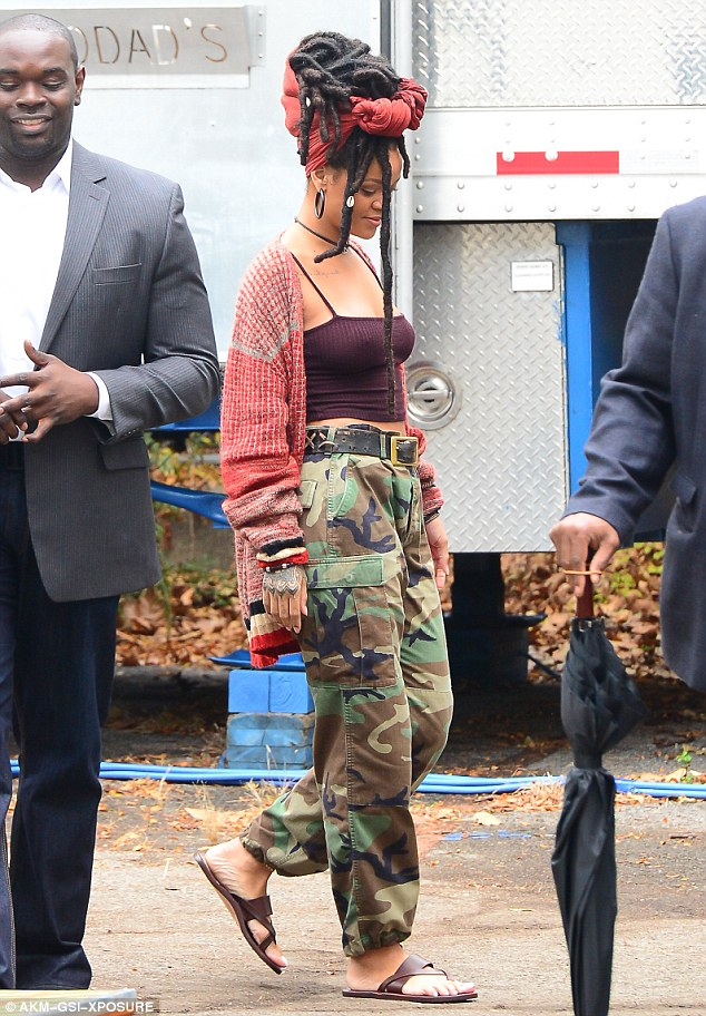 Relaxed: The Only Girl In The World hitmaker teamed the look with a pair of strappy brown leather sandals and a red knit sweater