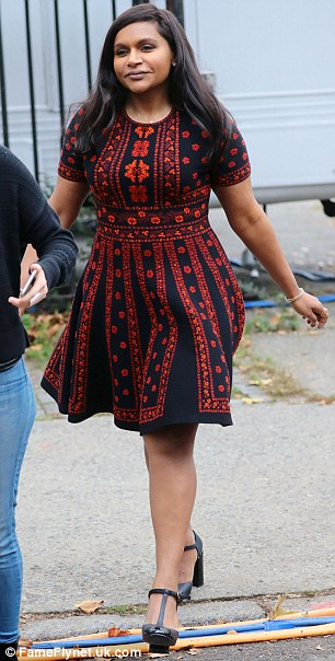 Pretty in patterns: Mindy Kaling sported a patterned black and red mini dress with patent leather heels