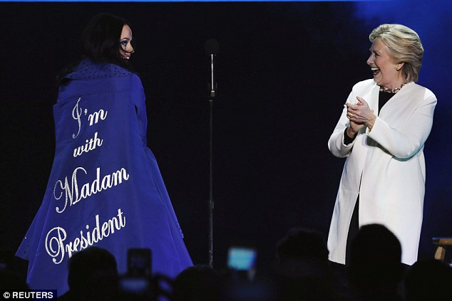 Dramatic entrance: The singer wore a cape embroidered with 'I'm with Madam President'