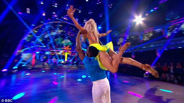 Flying high: He showed off his agility as he lifted his dance partner in the air mid-routine