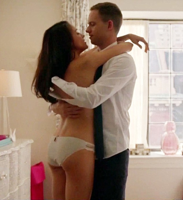 Risque: The actress strips down to her underwear in a steamy scene from US drama Suits