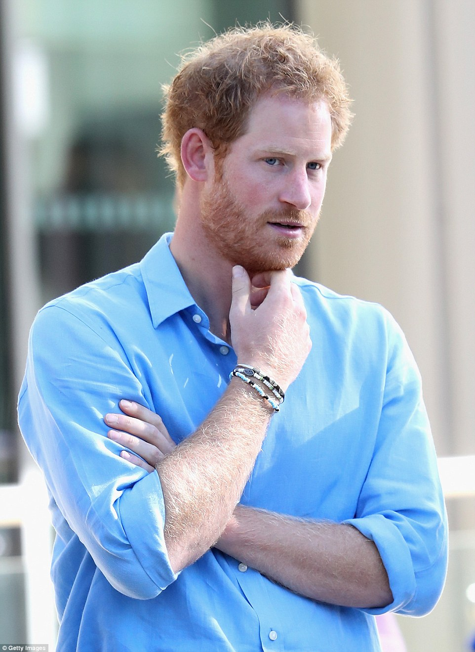 Prince Harry pictured in Aberdeen last month wearing a blue, white and black beaded bracelet that looks very much like the jewellery worn by his rumoured girlfriend Meghan