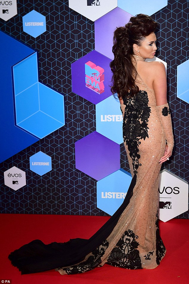 A night's tail: Going all out for the MTV EMAs, Charlotte showed off her figure in a custom-made gown