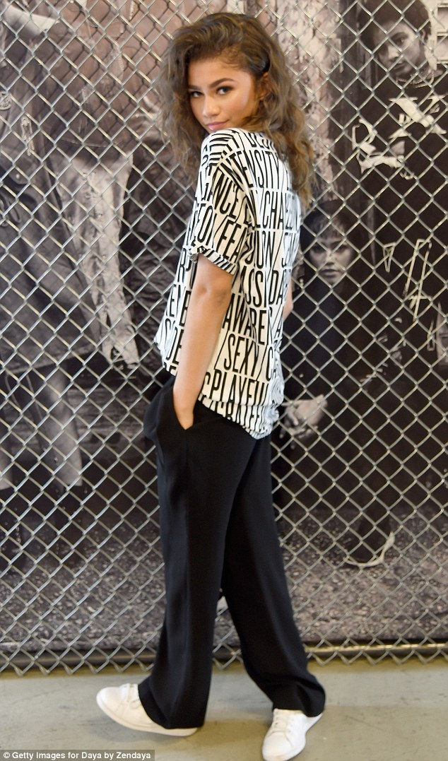 Comfy cute:She teamed the top with a pair of loose black slacks and fresh white sneakers