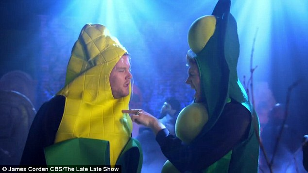 Getting the good stuff: The pair then have a boogie in a graveyard - mocking the spooky holiday by dressing in hilarious vegetable costumes of a corn on the cob and podded peas