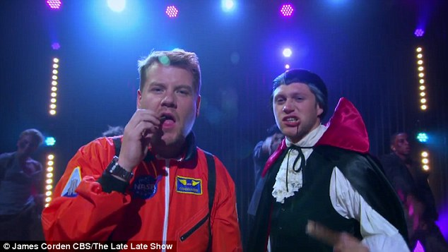 Sorry James: At the end of the video, the young One Direction star manages to nab his female admirer, while Corden aka Batman is hilariously left alone outside the door