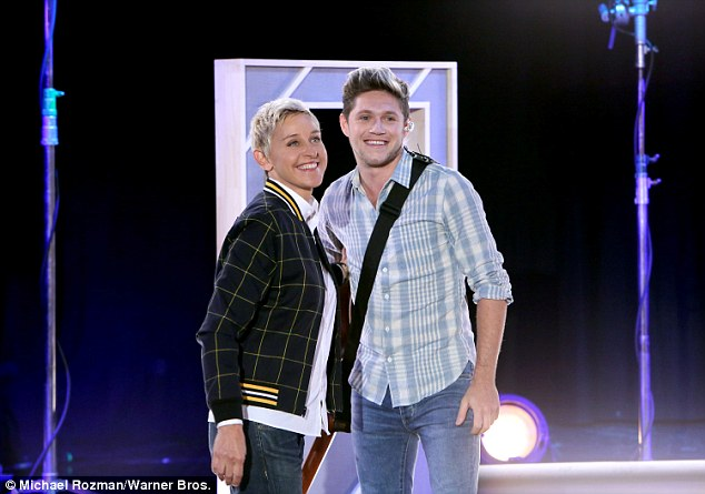 Revealing game: The star took part in a quick-fire game of Who¿d You Rather with chat show host Ellen, and ended up picking the Burn singer as his dream date