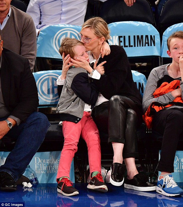 Off duty: Cate Blanchett, 47, took time off from filming on Wednesday to spend time with her sons Dashiell, 14, and Ronan, 12, at a basketball game in NYC