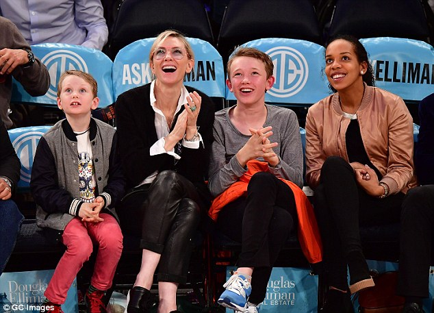 Having a ball! The trio looked in great spirits as they cheered on the New York Knicks from the front row in their battle against the Houston Rockets at Madison Square Garden
