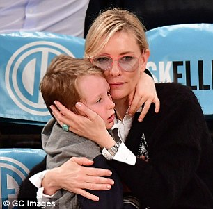 Sweet:Cate then enjoyed a more tender moment with her son Ronan - drawing him into a sweet hug