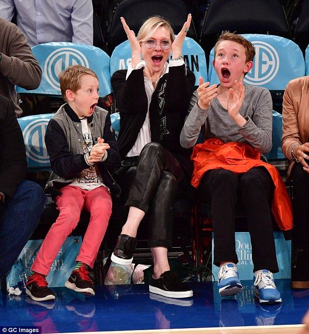 Go Knicks Go!Her sons could not contain their excitement as the players bounced up and down the court - opening their mouths wide in celebration when their team scored