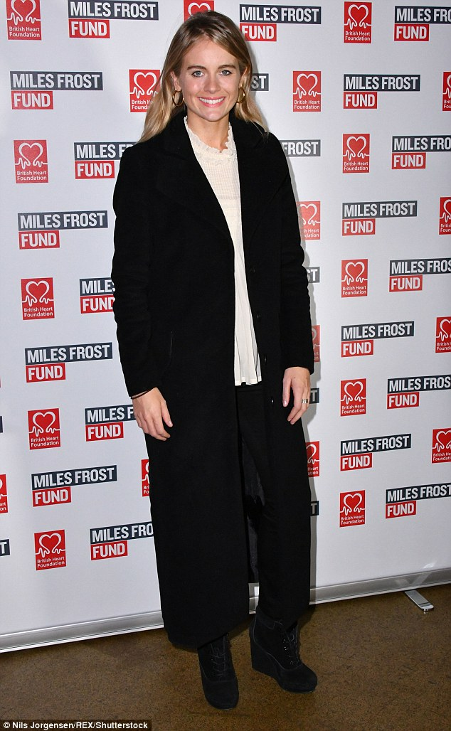 Feeling wintry? Cressida Bonas also attended, wearing a demure long black coat and a loose-fitting white top, accentuating her stature in high wedge ankle boots
