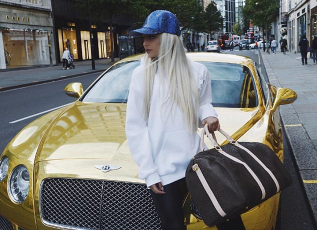 She has also pictured herselfdraped across the bonnet of a gold Bentley