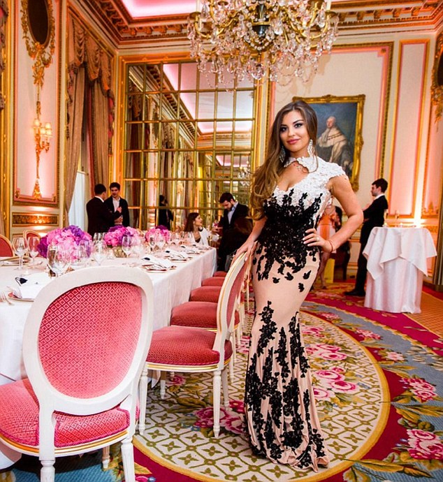 With her tumbling brunette locks and voluptuous curves, Alexandra Dmitrieva looks more like a glamorous model than a struggling student