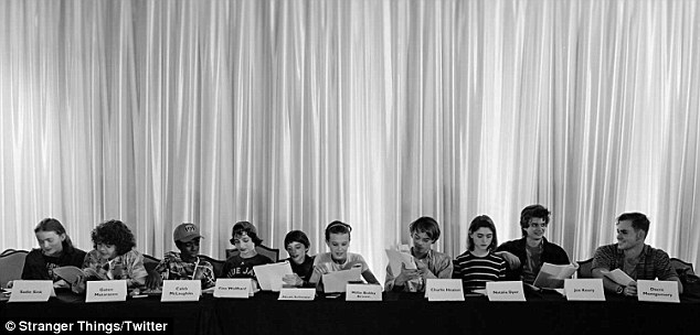 '011 is back!' Aside from Millie Bobby Brown (M) and other series regulars, the b&w snap included newcomers Sadie Sink (L) and Dacre Montgomery (R)
