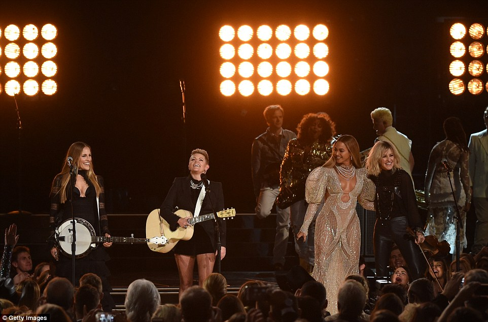 Collaboration: The 35-year-old star was joined by legendary groupThe Dixie Chicks - pictured from left to rightEmily Robison, Natalie Maines, and Martie Maguire - at the gala event