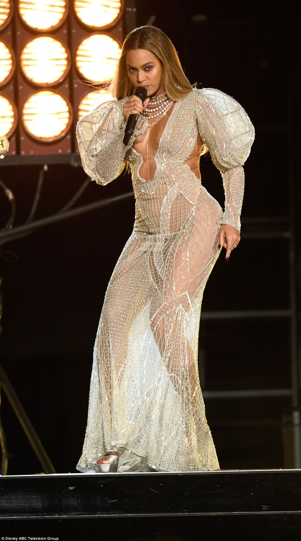Wow factor: Beyoncelooked absolutely stunning as always in a shiny white see-through gown