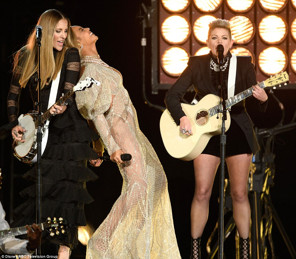 Comfortable customer: At one point during the perfromance Beyonce leaned back ontoEmily Robison