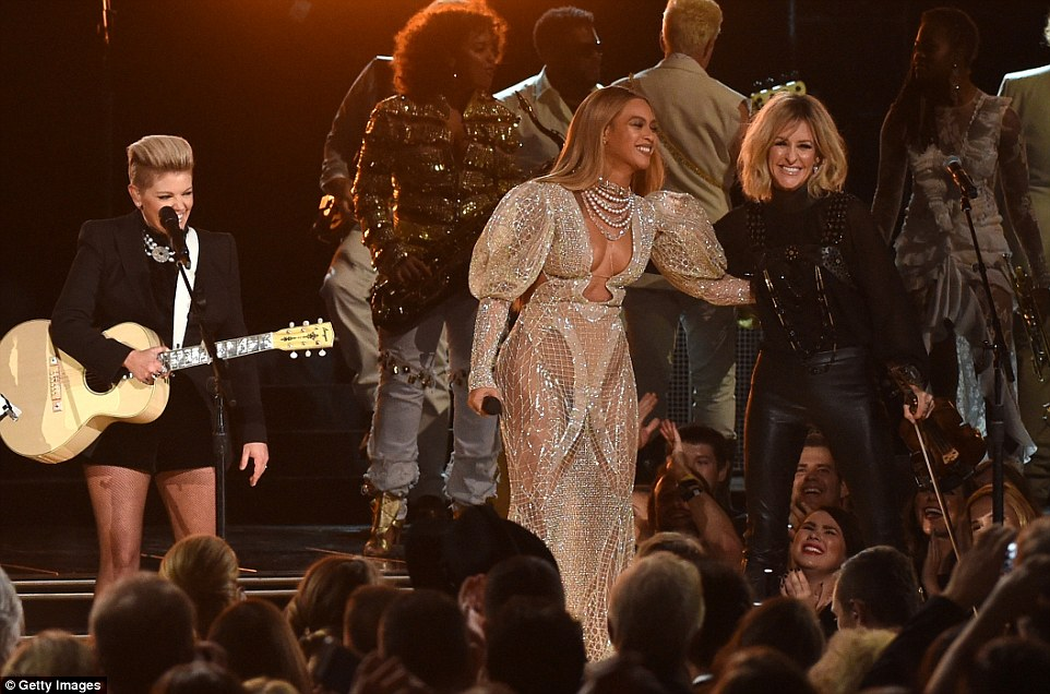 All love: Beyonce put her arm aroundMartie Maguire during the performance