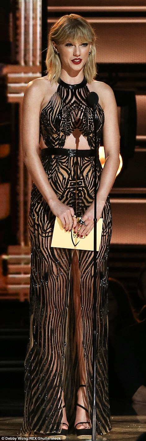 Gorgeous:The 26-year-old 1989 hitmaker stunned in a see through patterned halter gown featuring a thigh-high split down the middle