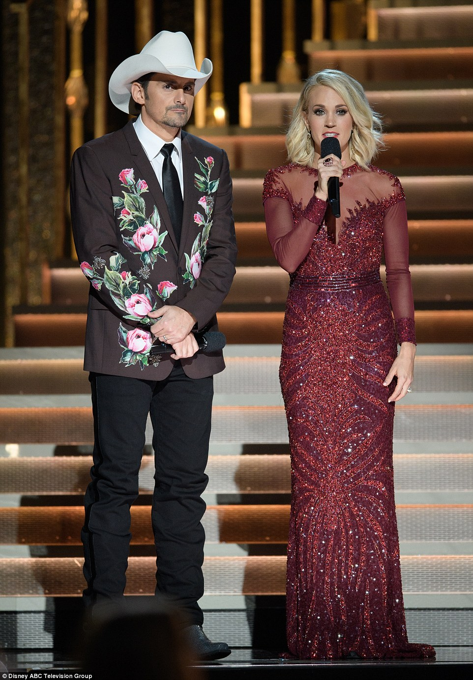 Ravishing in red: She had many outfit changes throughout the night as she and Brad paid tribute to famous looks from the award show's 50 years