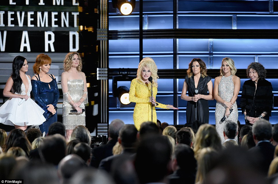 What a tribute:Kacey Musgraves, Reba McEntire, Jennifer Nettles, Dolly Parton, Martina McBride, Carrie Underwood, Lily Tomlin - pictured from left to right - on stage as the six women honoured Dolly with a tribute performance