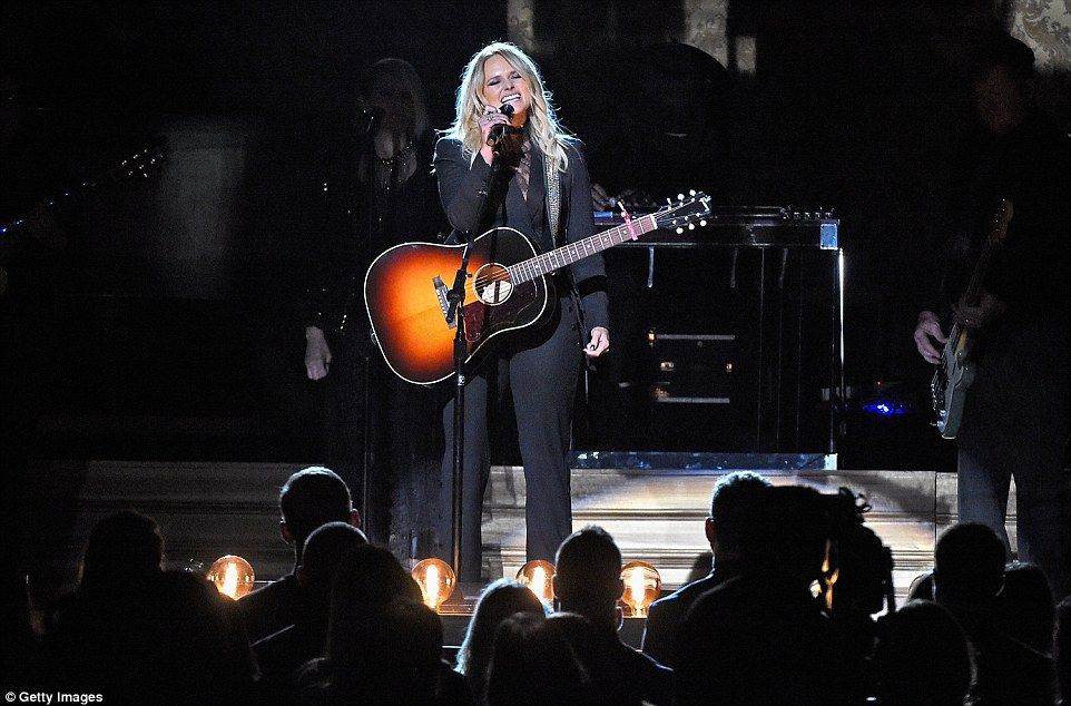 Stunning: The 32-year-old singer wore a black suit over a lacy top