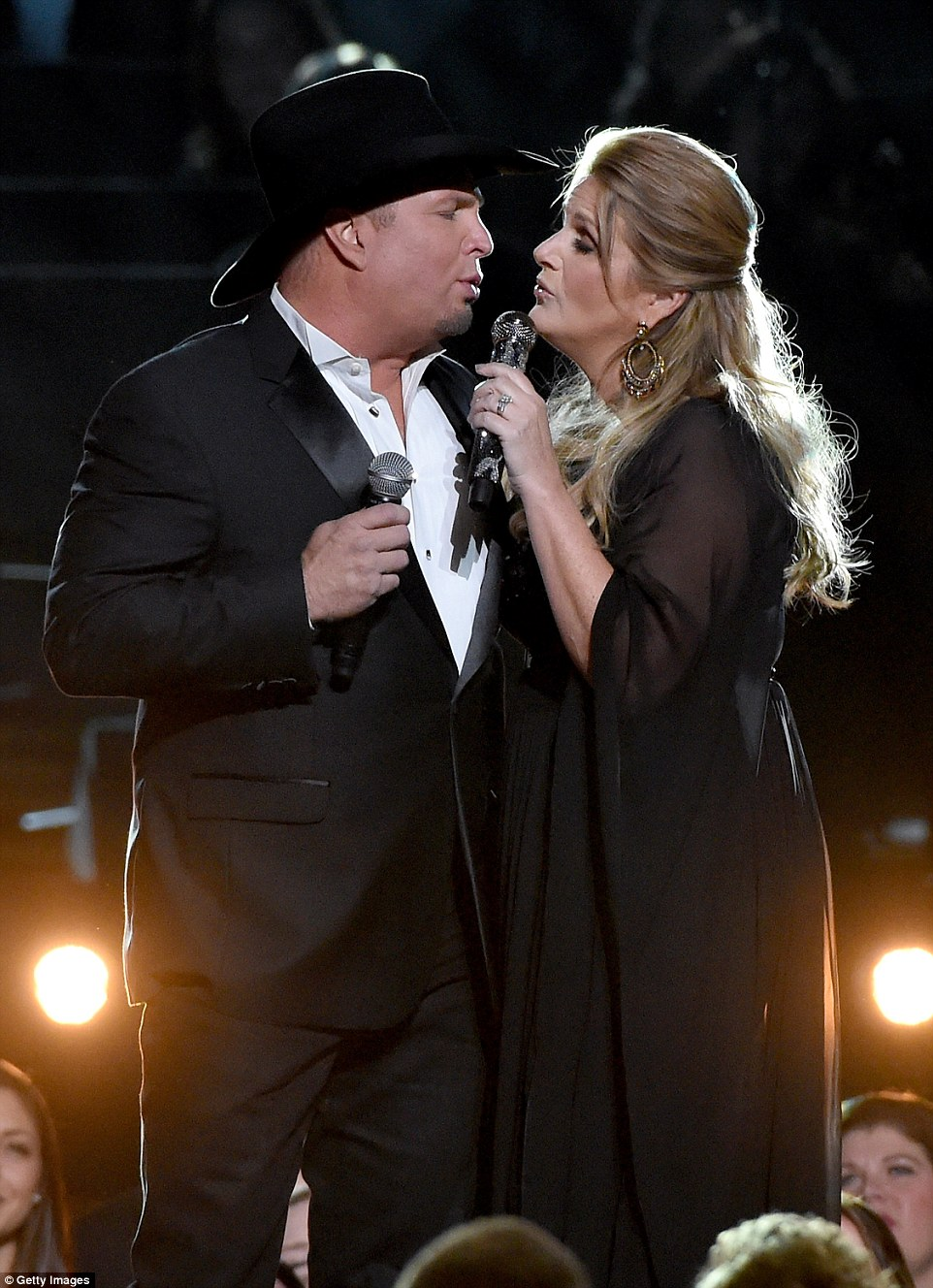 Loved up: Real-life couple Garth Brooks and Trisha Yearwood performed together