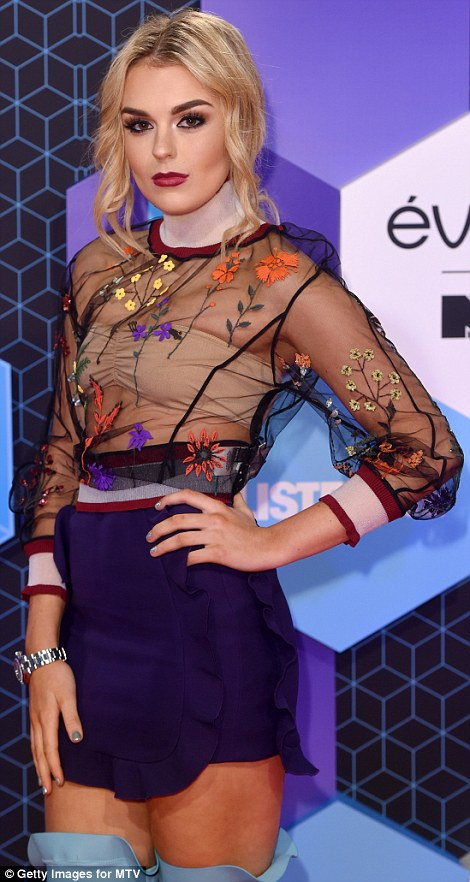 Colourful: Tallia Storm wore a sheer top embroidered with flowers and a pretty frilled purple mini skirt