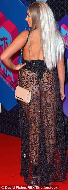 A striking show:Chloe Ferry sported a cop top and underwear covered with a sheer embroidered skirt