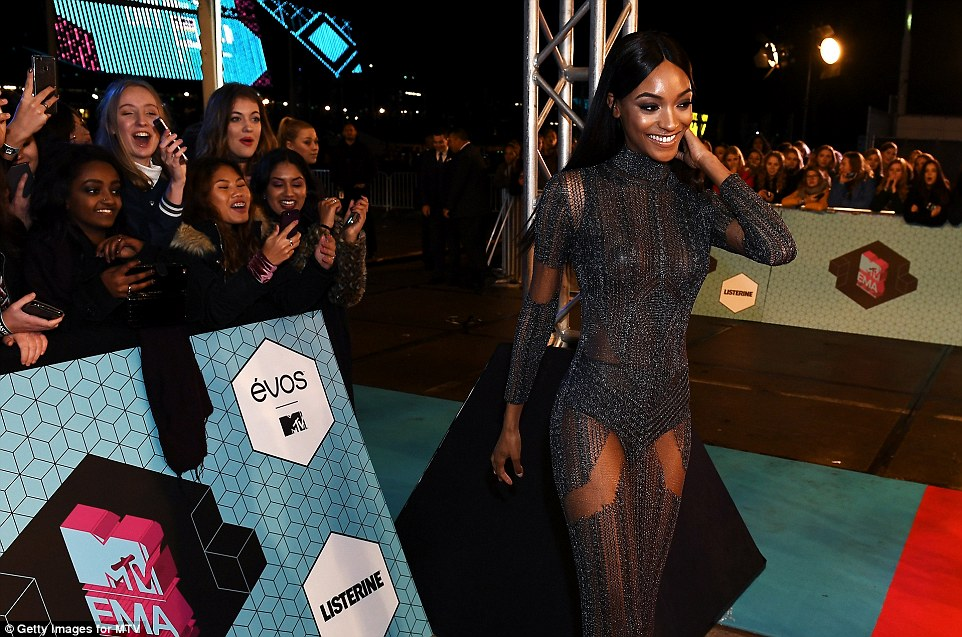 Fun time on the carpet: Jourdan was in cheerful spirits ahead of awarding the Best Male gong to Shawn Mendes