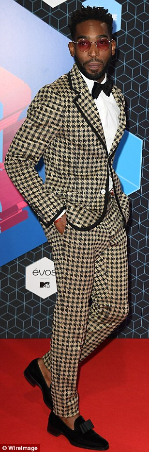 Man power:Tinie Tempah looked eclectic with a checked suit, while Jaden Smith sported a white jacket and jeans andAfrojack wore purple