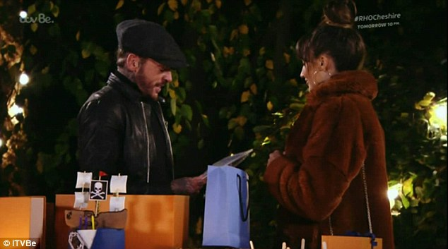 Baby steps: As the group gathered for Pete's al fresco birthday on Fireworks night, complete with toffee apples and presents, Megan took a moment to speak to her former beau