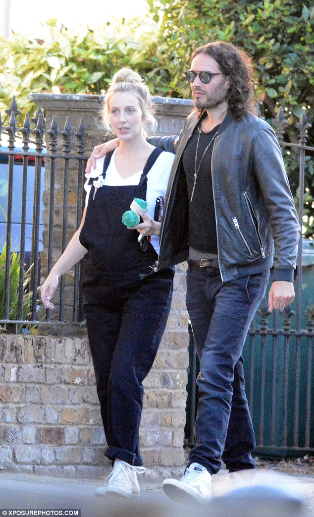 Proud new parents: Russell Brand, 41, has revealed he's become a father for the first time after welcoming a baby with girlfriend Laura Gallacher, 27