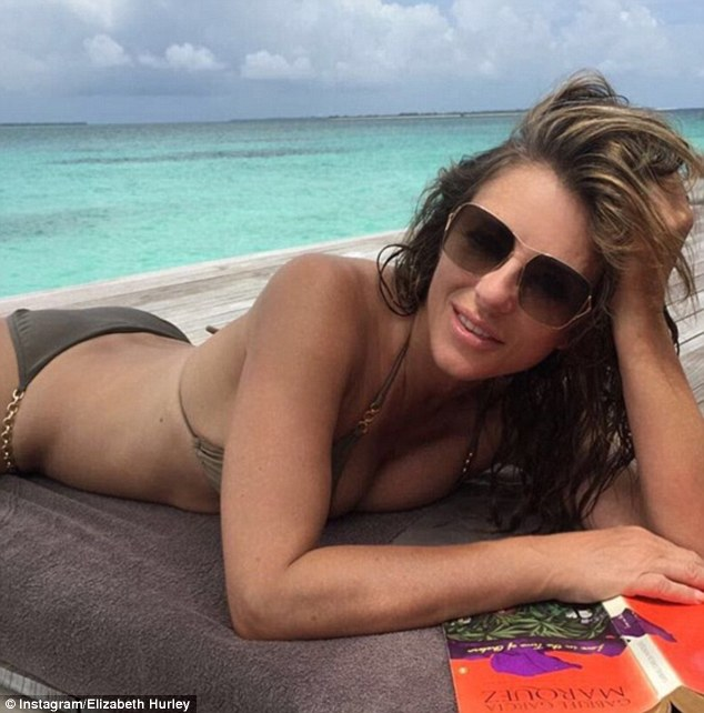 Reminiscing: Elizabeth Hurley, 51, took to Instagram on Monday to show off her enviably slim figure and flawless complexion in a throwback bikini snap