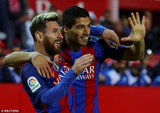 Star of the show: Barcelona's Luis Suarez celebrated with Lionel Messi after scoring his 500th goal, winning the game for Barcelona