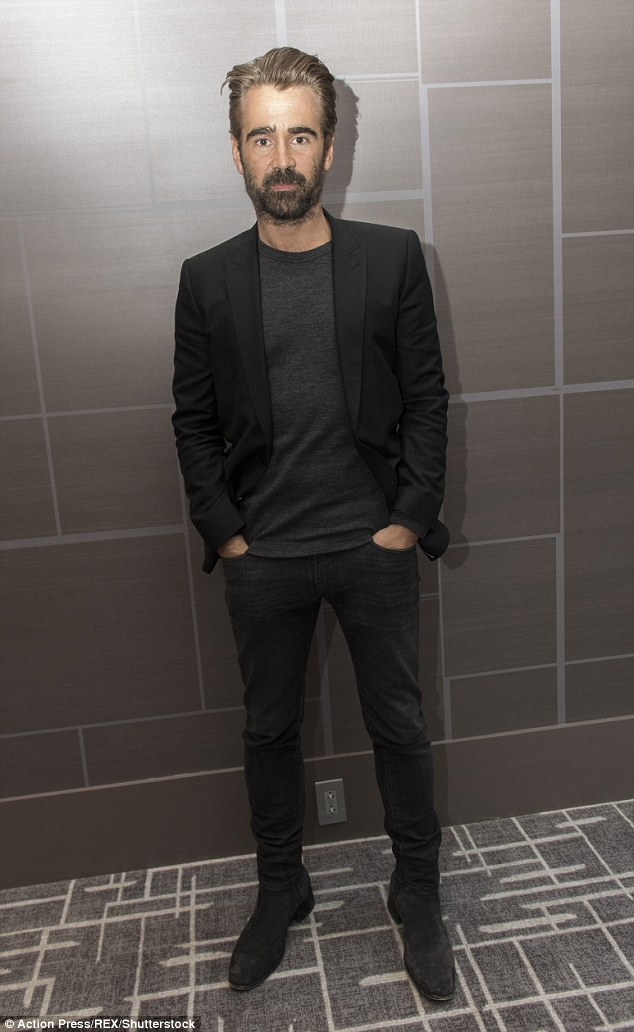 Low-key: The actor attended the phto call in a monochrome ensemble, consisting of black skinny jeans, a grey top and a black blazer