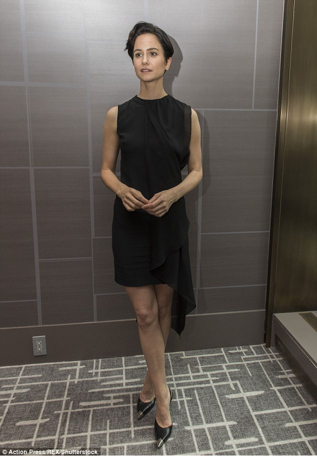 Standing tall: The 36-year-old actress - who rose to fame in the 2007 film Michael Clayton - added height to her frame with a pair of pointy black stilettos with metallic silver toe-caps