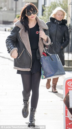 On-trend: A stylish fleece lined leather jacket and chunky boots completed her look