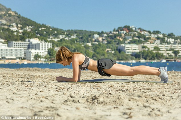 Keep going! The 26-year-old stunner flaunted her abs of steel while holding a plank and wearing  a sports bra and matching pair of barely-there shorts