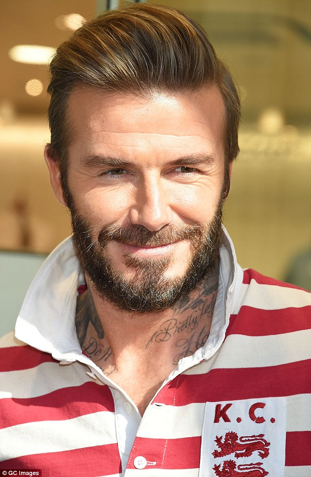 Happy shopper:The bearded star wore his honey locks in a smart quiff as he stepped out on Monday