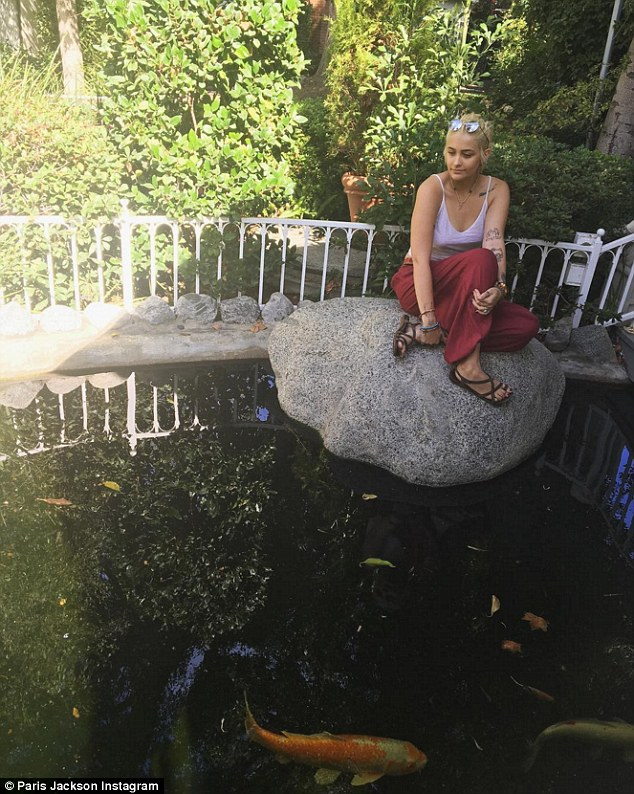 Relaxing: Paris also posted  pictures which appeared to be of the beautiful Self-Realization Fellowship Lake Shrine and garden on Sunset Blvd in Pacific Palisades, California