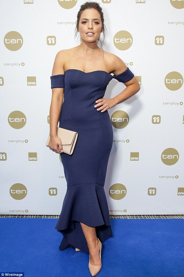 Enviable curves: Olympia highlighted her figure in an off-the-shoulder blue frock