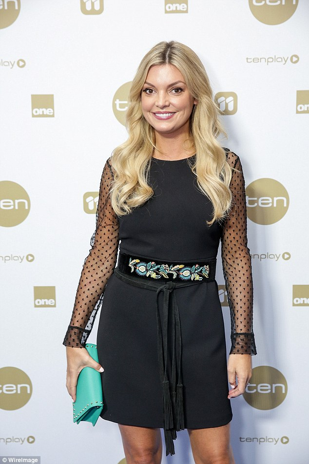 TV presenter Natalie Hunter wore an eye-catching black dress with sheer arms