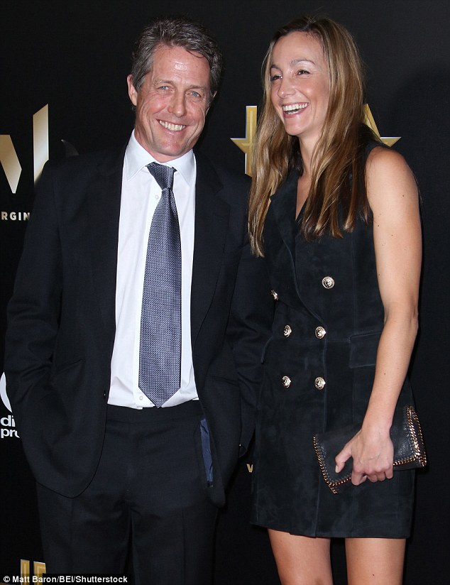 Loved-up:The pair looked comfortable in each other's company as they posed and laughed on the red carpet for the cameras