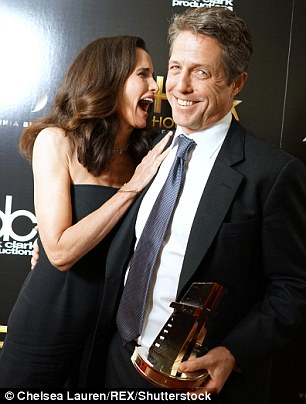 Old friends: Hugh also reunited with actress Andie MacDowell on the carpet - who he starred alongside in Four Weddings