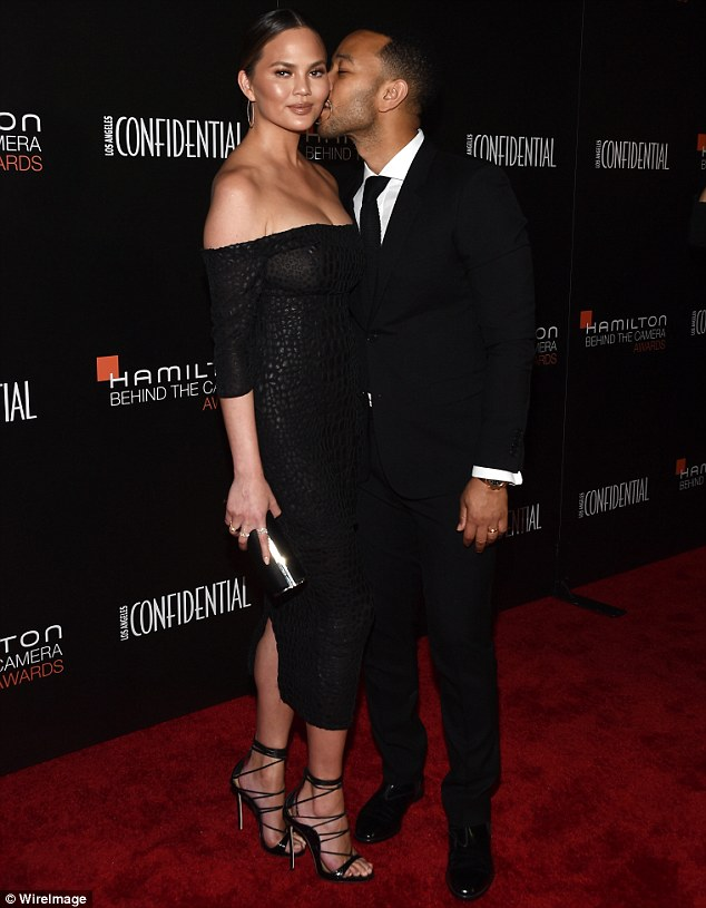 So in love: The model and her husband John Legend made for one very cute couple as they cuddled and chatted on the red carpet