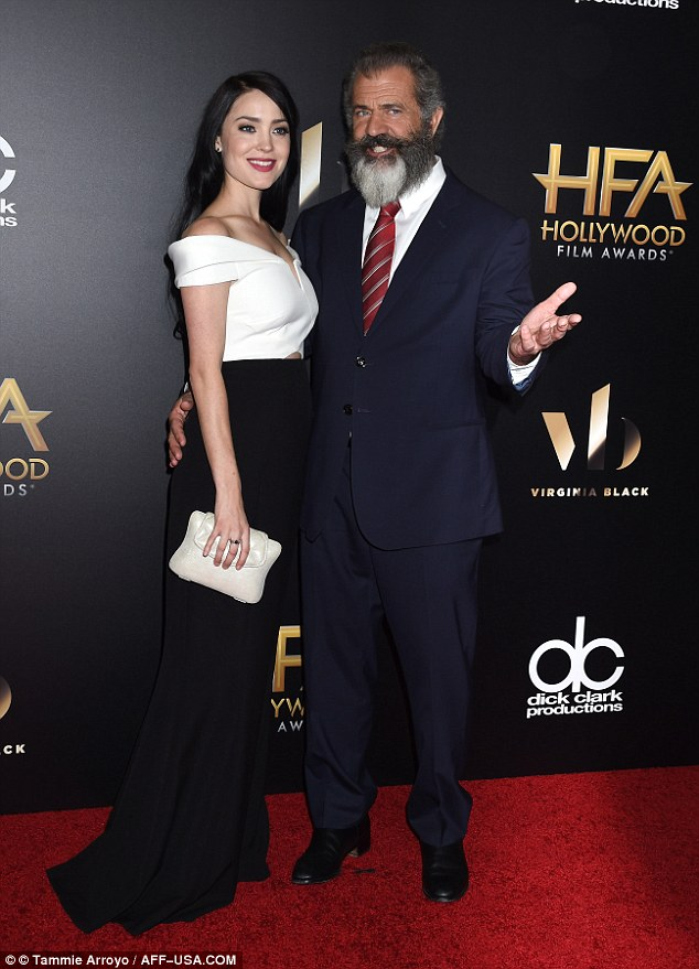 Back in the high life: Mel Gibson, 60, looked dapper as he walked the red carpet with his pregnant girlfriend Rosalind Ross, 26