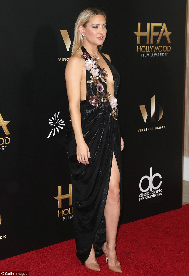 Jaw-dropping: The 37-year-old actress flaunted her fantastic figure in a deep, V-neck Marchesa dress, which featured a thigh-high slit and embroidered flowers
