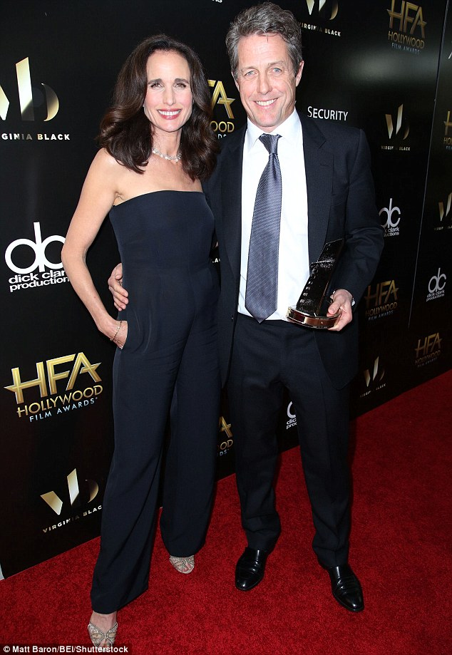 Hugh beauty: Grant posed up with Four Weddings co-star Andie MacDowell after she handed over his supporting actor gong at the Hollywood Film Awards on Sunday